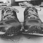 Black and white photo of trail running shoes.